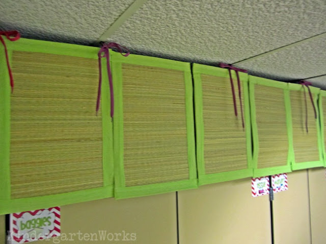 21 Classroom Things Worth Purchasing from the Dollar Tree - I love bamboo and green. When I found these lime-green border placemats I knew they were the perfect solution to hiding my eye-sore science kits. I've got you hooked up with my no-sew tutorial on how I used shoelaces and pins to create a curtain above my cupboards. I also have two more hung on a wall in my classroom to create a calming wall hanging and to break up some visual space.