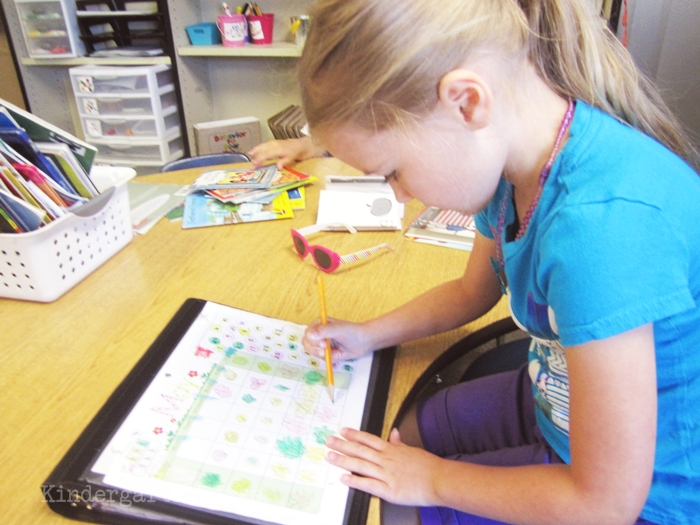 How to Organize and Use Classroom Reward Coupons in Kindergarten - sit in teacher's chair