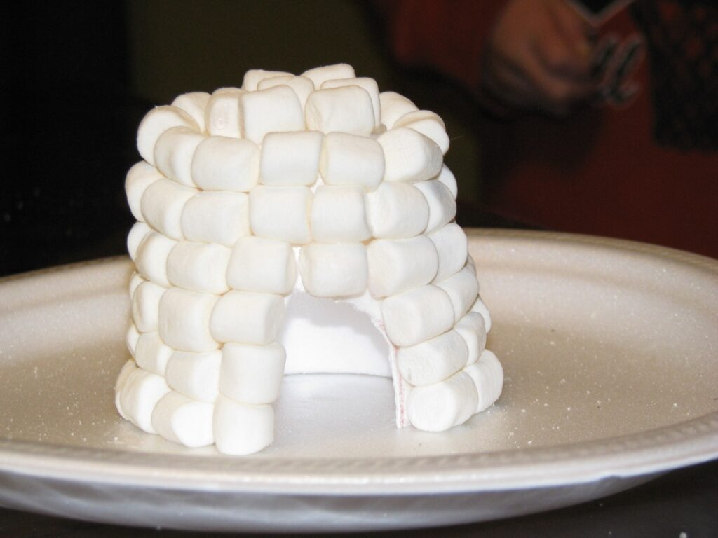 Igloo made from mini-marshmallows on styrofoam plate
